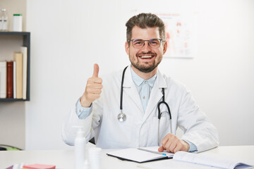 happy doctor showing thumb up gesture with smile on face