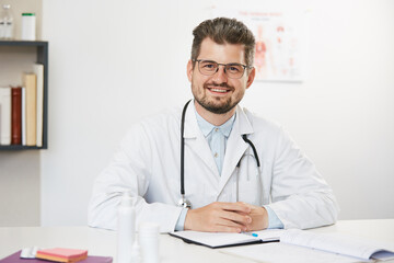 handsome kind professional doctor at modern clinic