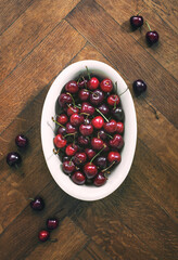Summersweet cherries in a dish, overhead view