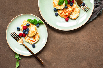 Pancakes with summer berries served for breakfast, copy space for a text