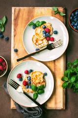 Pancakes with summer berries served for breakfast, overhead view