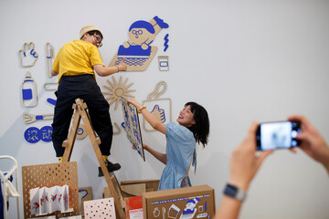 Exhibitors hang art work at the abC Art Book Fair following an outbreak of the coronavirus disease (COVID-19) in Beijing