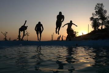 Palestinians build pool on rocky hills for summer-time fun during COVID-19