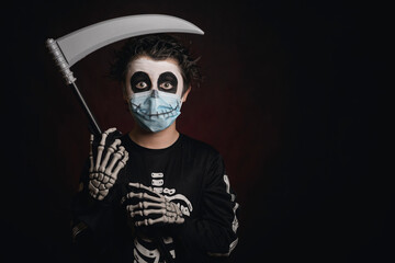 Happy Halloween. kid wearing medical mask in a skeleton costume with a scythe