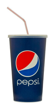 Cup of Pepsi Cola with Straw - Oct 2011.London, England - January 22, 2010: Cup of Pepsi Cola with Straw, The Pepsi Brand is owned by PepsiCo Inc.