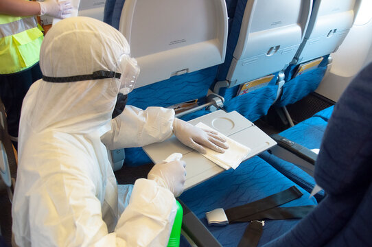 Coronavirus pandemic virus prevention. Airlines interior cabin deep cleaning for Covid-19.
