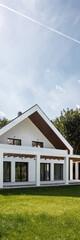 Beautiful house in sunlight, vertical panorama