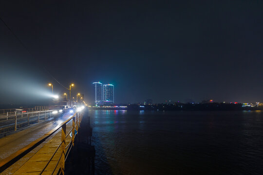 Train on Cau Long Bien bridge at night in Hanoi, Vietnam