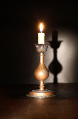 Lighting Candle On Dark