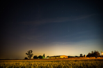 Cestlice, Czech republic - July 22, 2020. Building of shooting range in the field at night with comet C/2020 F3 Neowise above