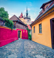 Printed roller blinds Eastern Europe Fabulous morning view of famous medieval fortified city and the Clock Tower built by Saxons. Colorful summer cityscape of Sighisoara, Transylvania, Romania, Europe. Traveling concept background.