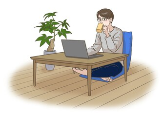 A man working remotely with a cup of coffee