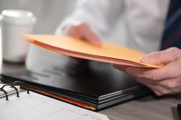 Businessman holding folder - fototapety na wymiar