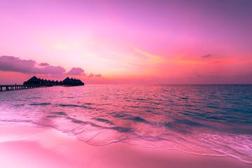 Sunset in the Maldives. Luxury resort villas water bungalows