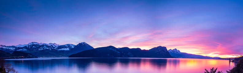 Sunset panorama in the Alps mountains. Lake Lucerne, Switzerland.