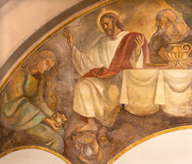 BARCELONA, SPAIN - MARCH 3, 2020: The fresco of scene The Supper Of Jesus by Simon the Pharisee in the church Parroquia Santa Teresa de l'Infant Jesus by Francisco Labarta (20. cent.).