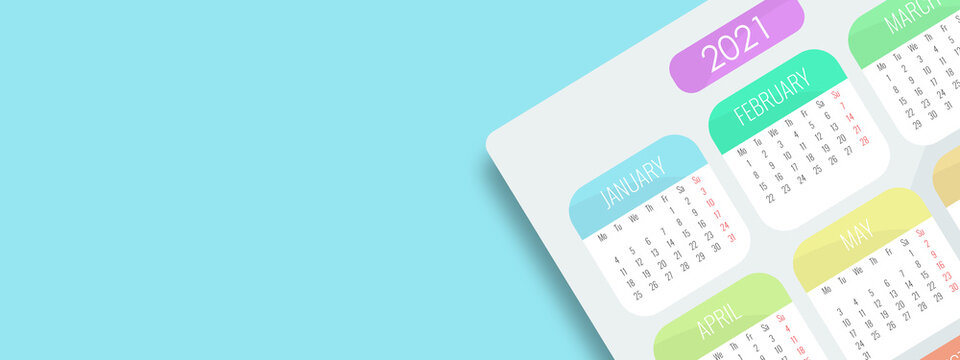 Top view of 2021 calendar sheet. The card is arranged at an angle. Shadow falling on a blue broad and long pastel background. Copy free space for your artwork. Planning for business meeting or travel.
