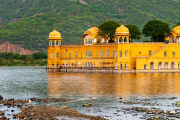 Jal Mahal palace in the evening in Jaipur, India. Popular landmark surrounded by water