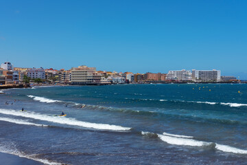 views of the bohemian town in the south east part of the island, with first line residences in front of a popular beach at El Medano, Tenerife, Canary Islands, Spain