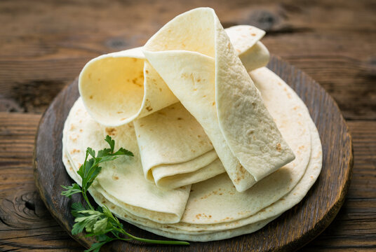 Whole wheat flour tortilla on the wooden table background