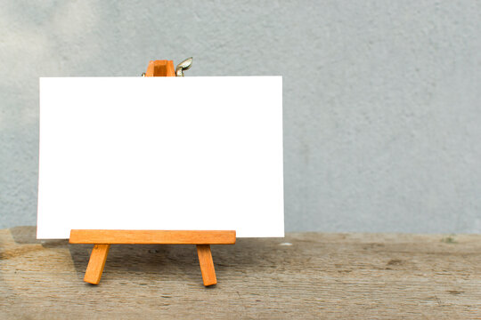 Blank canvas on an easel. Empty place. Mock up, template. White sheet of paper on a stand