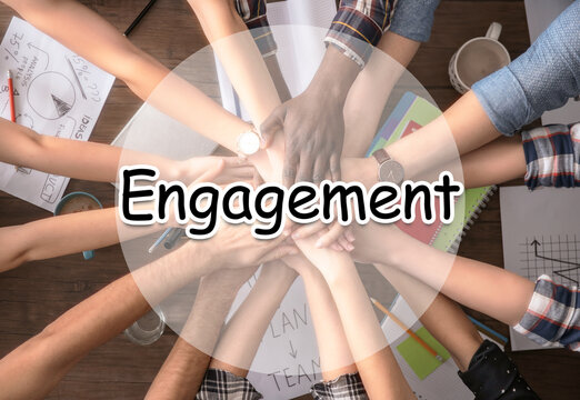 Engagement concept. People holding hands together over table, top view