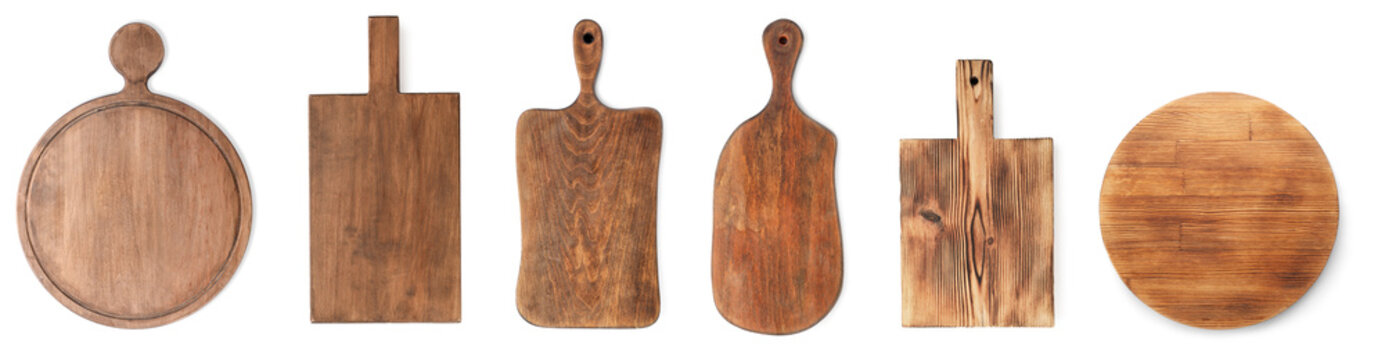 Set with different wooden boards on white background, banner design. Cooking utensils