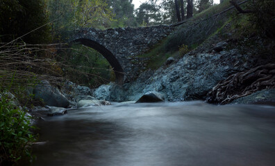 Ancient stone Venetian bridge in the Troodos mountains on the island of Cyprus.
