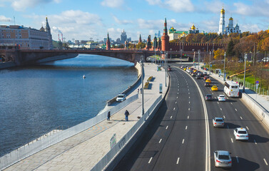 October 22, 2017 Moscow, Russia. Cars on Moskvoretskaya embankment, Zaryadye Park and a view of the Moscow Kremlin.