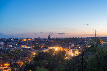 April 27, 2018 Vilnius, Lithuania. View of the old city of Vilnius from Three Cross Mountain at night.