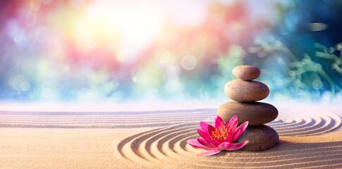 Lotus Flower With Spa Stones In Rock Garden  - fototapety na wymiar
