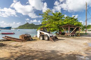 Acrylic Prints Shipwreck Broken front-loader in Tyrell bay beach, Carriacou, Grenada