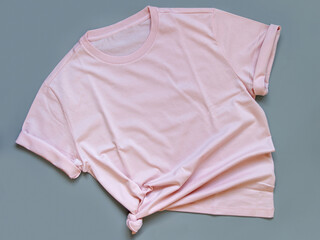 Pink t-shirt mock up flat lay on grey background