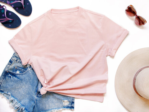 Mockup of a pink t-shirt placed between some beach accessories
