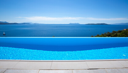 Beautiful blue infinity pool with a sea view