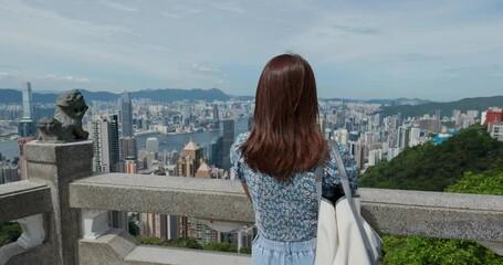 Wall Mural - Woman visit Hong Kong, enjoy the city view