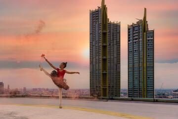 girl street ballet dance on skyscraper rooftop in city