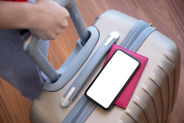 female hands holding suitcase and phone with isolated screen airport