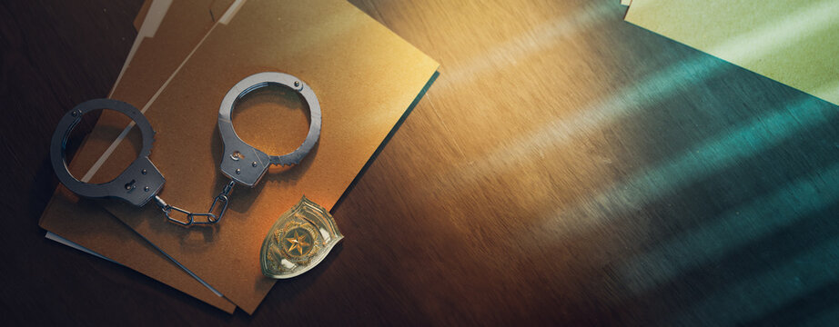 Police officer badge with handcuffs on a dark background ( 3D rendering, illustration )