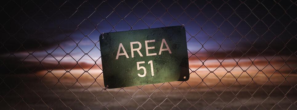 Area 51 sign on a fence at dusk. (3D Rendering, illustration)