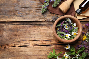 Tuinposter Europa Flat lay composition with mortar and different healing herbs on wooden table, space for text
