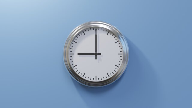Glossy chrome clock on a blue wall at nine o'clock. Time is 09:00 or 21:00
