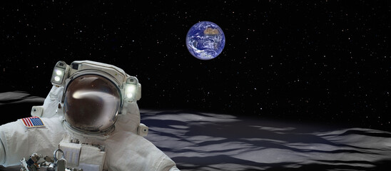 Wall Mural - An astronaut walking on the moon and amazing comet reflection on astronaut's helmet - The Earth as Seen from the Surface of the Moon-Astronaut watching