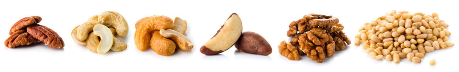 set nuts isolated on white background, Brazil nut, walnut, almond, pine nut