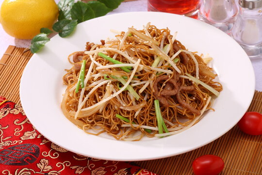 Close up of a typical Hong Kong and Cantonese style cuisine Soy sauce fried noodle with bean sprouts and shredded pork