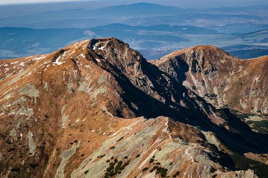 Arid mountain landscape. Main Western Tatras ridge seen from the Pachoa peak, Slovakia, Europe.