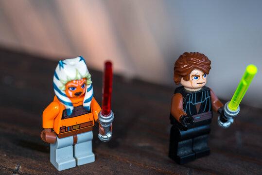 Miercurea Ciuc, Romania- 26 July 2020: Anakin Skywalker and Ashoka Tano Lego figurines holding the lightsabers.