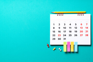 close up of calendar on the green table background, planning for business meeting or travel planning concept