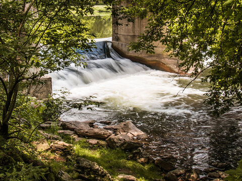 Water streams through a spillway at Gring's Mill park in Berks County, PA
