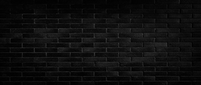 Black brick wall wide panorama of masonry